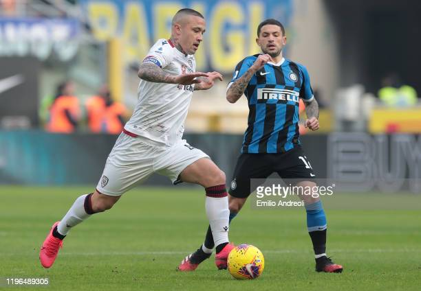 Radja Nainggolan of Cagliari Calcio is challenged by Stefano Sensi of FC Internazionale during the Serie A match between FC Internazionale and...