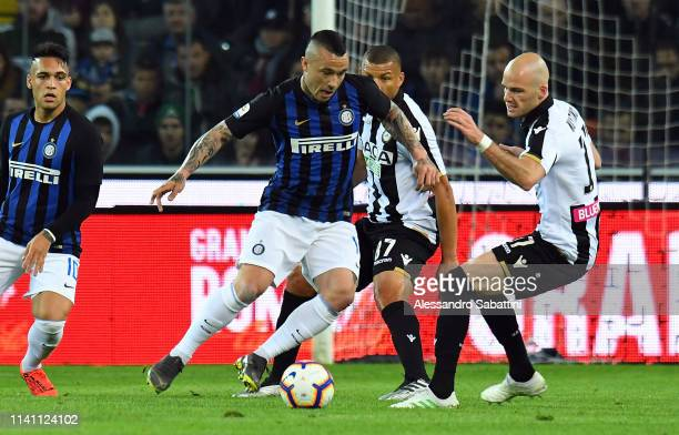 Radja Nainggolan of FC Internazionale competes for the ball with Bram Nuytinck of Udinese Calcio during the Serie A match between Udinese and FC...