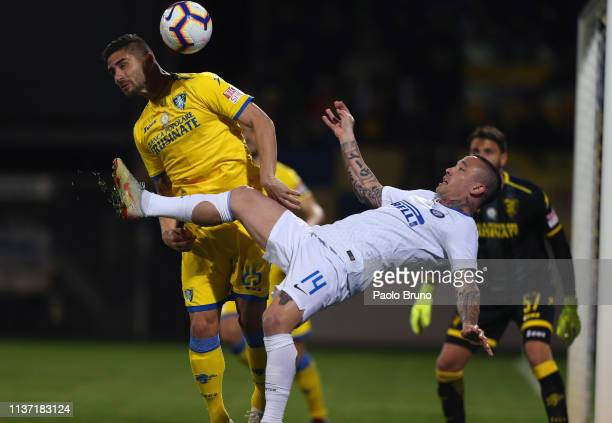 Radja Nainggolan of FC Internazionale competes for the ball with Marco Capuano of Frosinone Calcio during the Serie A match between Frosinone Calcio...
