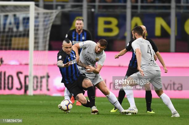 Radja Nainggolan of FC Internazionale competes for the ball with Aleksandar Kolarov of AS Roma during the Serie A match between FC Internazionale and...