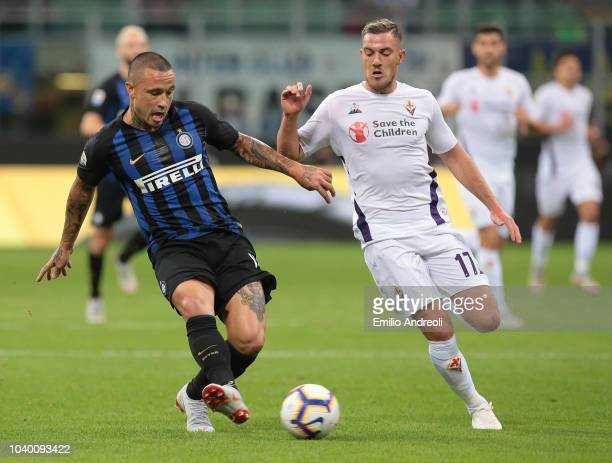 Radja Nainggolan of FC Internazionale is challenged by Jordan Veretout of ACF Fiorentina during the Serie A match between FC Internazionale and ACF...