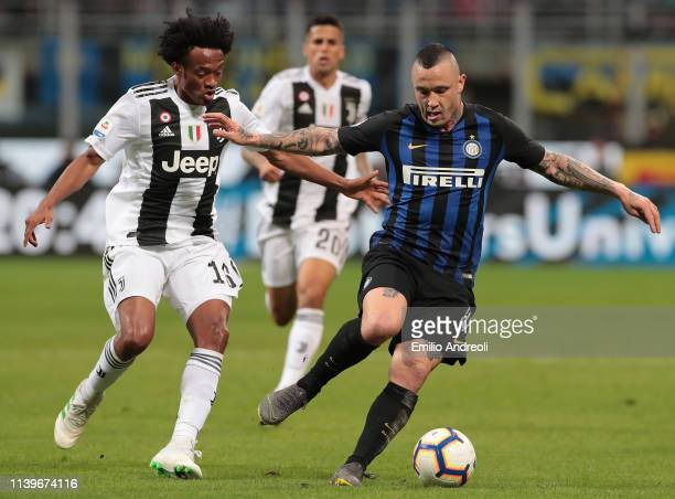 Radja Nainggolan of FC Internazionale is challenged by Juan Cuadrado of Juventus during the Serie A match between FC Internazionale and Juventus at...