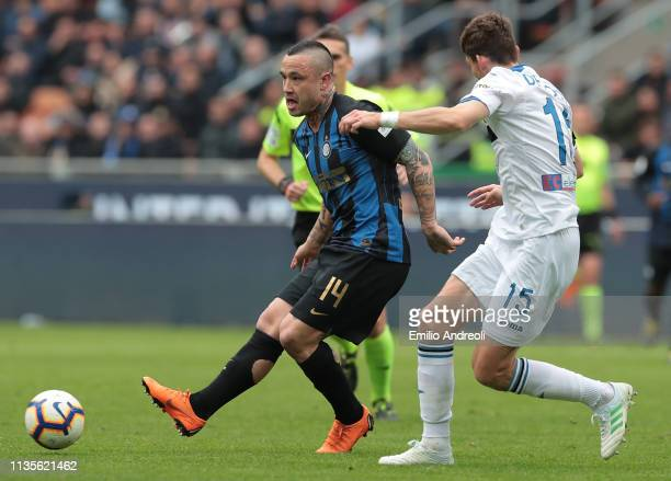 Radja Nainggolan of FC Internazionale is challenged by Marten De Roon of Atalanta BC during the Serie A match between FC Internazionale and Atalanta...