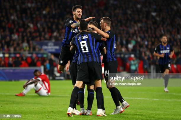 Radja Nainggolan of Inter Milan celebrates with team mates after scoring his team's first goal during the Group B match of the UEFA Champions League...
