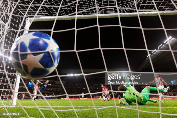 Radja Nainggolan of Inter Milan scores his team's first goal past Jeroen Zoet of PSV Eindhoven during the Group B match of the UEFA Champions League...