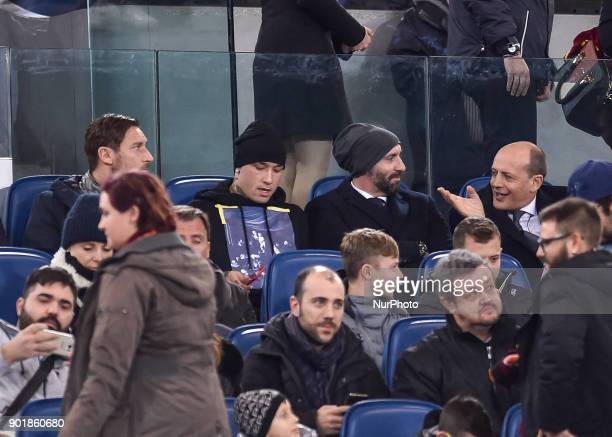 Radja Nainggolan of Roma assists to the match from the stands with Francesco Totti and Monchi during the Serie A match between Roma and Atalanta at...