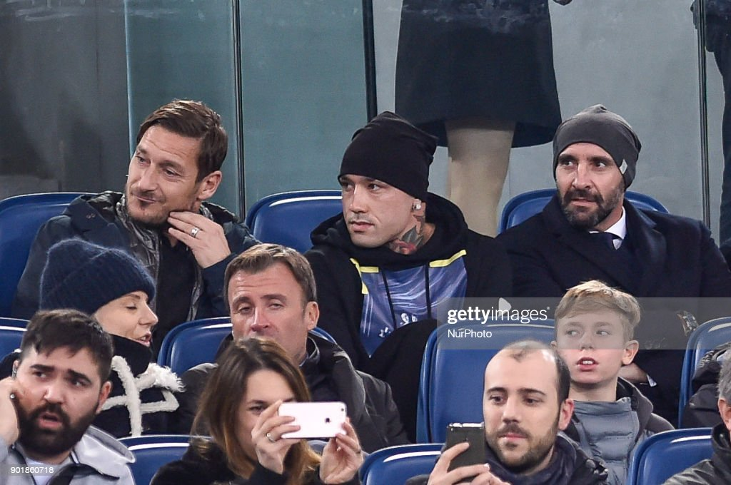 Radja Nainggolan of Roma assists to the match from the stands with Francesco Totti and Monchi during the Serie A match between Roma and Atalanta at Stadio Olimpico, Rome, Italy on 6 January 2018