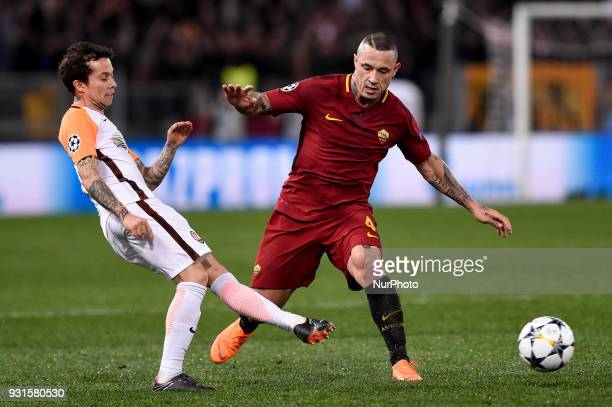 Radja Nainggolan of Roma is challenged by Bernard of Shakhtar Donetsk during the UEFA Champions League Round of 16 match between Roma and Shakhtar...