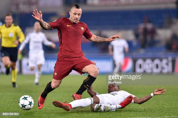 Radja Nainggolan of Roma is challenged by Donald Guerrier of Qarabag during the UEFA Champions League match between Roma and Qarabag at Stadio...