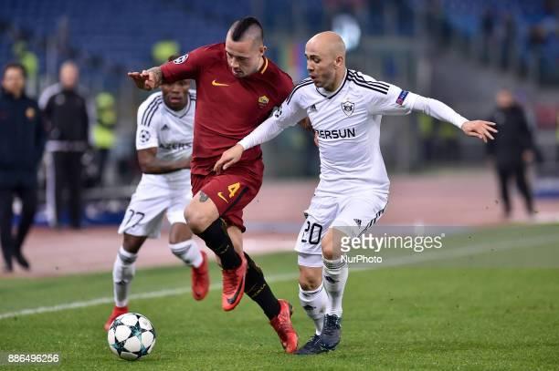 Radja Nainggolan of Roma is challenged by Richard Almeida of Qarabag during the UEFA Champions League match between Roma and Qarabag at Stadio...