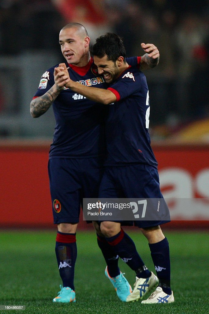 Radja Nainggolan (L) with his teammate Marco Sau of Cagliari Calcio celebrates after scoring the opening goal during the Serie A match between AS Roma and Cagliari Calcio at Stadio Olimpico on February 1, 2013 in Rome, Italy.