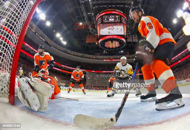 Radko Gudas and Ivan Provorov of the Philadelphia Flyers defend the net of Brian Elliott against Sidney Crosby of the Pittsburgh Penguins in Game...
