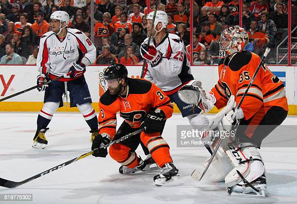 Radko Gudas and Steve Mason of the Philadelphia Flyers defend their goal against Jason Chimera and Alex Ovechkin of the Washington Capitals on March...