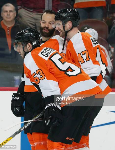 Radko Gudas Andrew MacDonald and Shayne Gostisbehere of the Philadelphia Flyers look on during warmups prior to their game against the Boston Bruins...