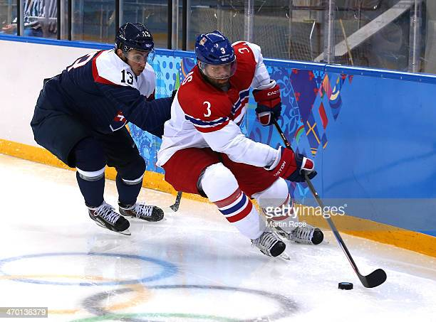 Radko Gudas of Czech Republic handles the puck against Tomas Jurco of Slovakia in the third period during the Men's Qualification Playoff Game on day...