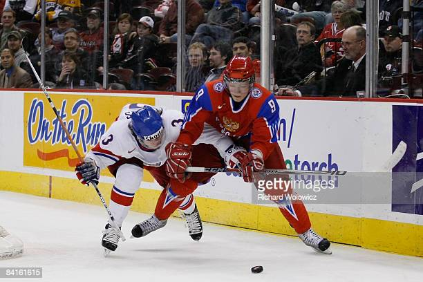 Radko Gudas of Team Czech Republic and Dmitri Klopov of Team Russia battle for the puck during the quarterfinals at the IIHF World Junior...