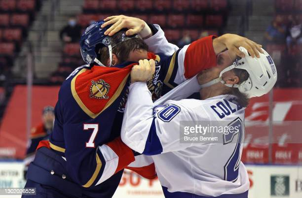 Radko Gudas of the Florida Panthers fights with Blake Coleman of the Tampa Bay Lightning during the third period at the BB&T Center on February 13,...