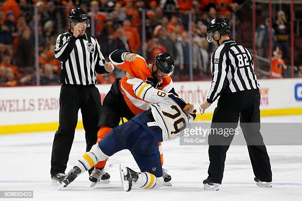 Radko Gudas of the Philadelphia Flyers and Jake McCabe of the Buffalo Sabres fight in the third period at Wells Fargo Center on February 11 2016 in...