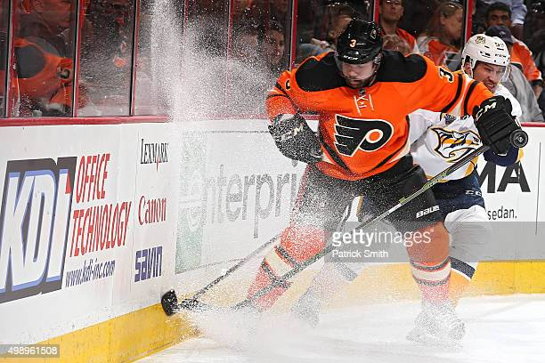 Radko Gudas of the Philadelphia Flyers and Roman Josi of the Nashville Predators battle for the puck in the first period at Wells Fargo Center on...