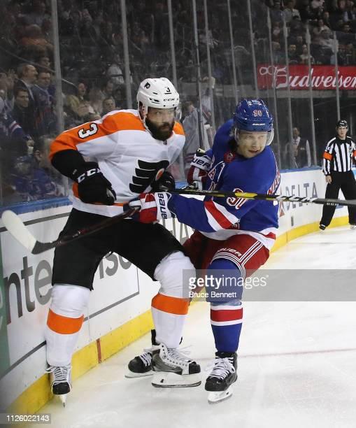 Radko Gudas of the Philadelphia Flyers and Vladislav Namestnikov of the New York Rangers battle for position during the second period at Madison...