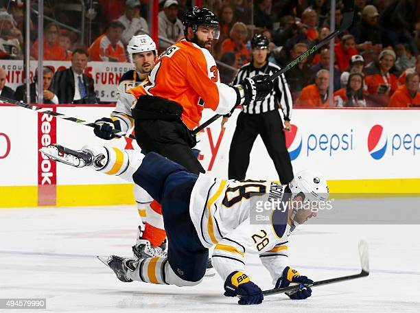 Radko Gudas of the Philadelphia Flyers and Zemgus Girgensons of the Buffalo Sabres collide in the third period on October 27 2015 at the Wells Fargo...