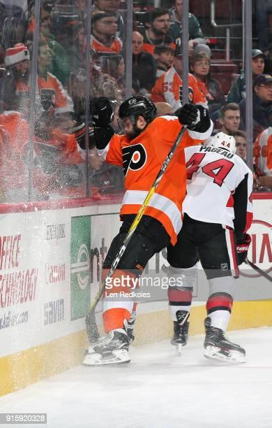 Radko Gudas of the Philadelphia Flyers battles along the boards against JeanGabriel Pageau of the Ottawa Senators on February 3 2018 at the Wells...