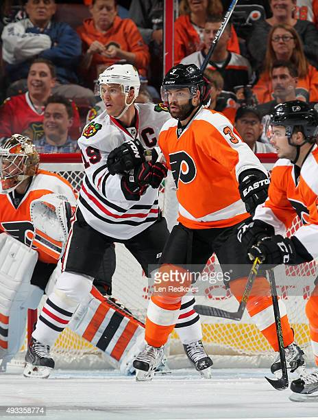 Radko Gudas of the Philadelphia Flyers battles in the crease against Jonathan Toews of the Chicago Blackhawks on October 14 2015 at the Wells Fargo...