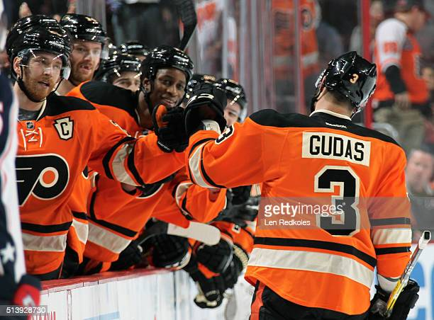 Radko Gudas of the Philadelphia Flyers celebrates his first period goal against the Columbus Blue Jackets with his teammates on the bench on March 5...