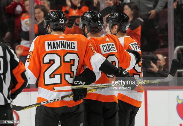 Radko Gudas of the Philadelphia Flyers celebrates his second period goal against the New Jersey Devils with Brandon Manning and Valtteri Filppula on...