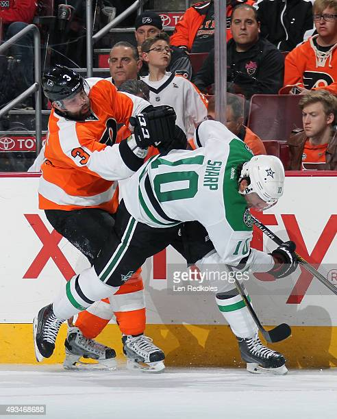 Radko Gudas of the Philadelphia Flyers checks Patrick Sharp of the Dallas Stars along the boards in NHL action on October 20 2015 at the Wells Fargo...