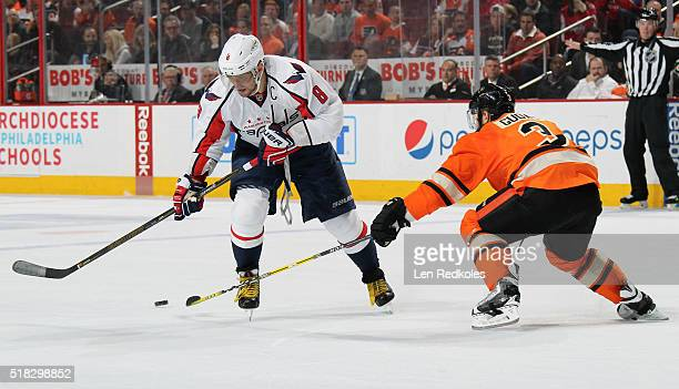 Radko Gudas of the Philadelphia Flyers defends against Alex Ovechkin of the Washington Capitals on March 30 2016 at the Wells Fargo Center in...