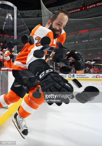 Radko Gudas of the Philadelphia Flyers dumps the pucks onto the ice surface for warmups against the Boston Bruins on April 1 2018 at the Wells Fargo...