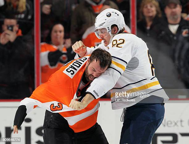 Radko Gudas of the Philadelphia Flyers fights Marcus Foligno of the Buffalo Sabres in the second period on February 11 2016 at the Wells Fargo Center...