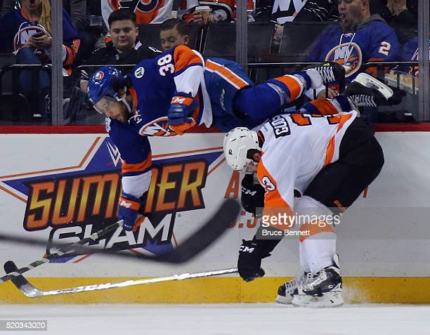 Radko Gudas of the Philadelphia Flyers gets under Bracken Kearns of the New York Islanders during the third period at the Barclays Center on April 10...