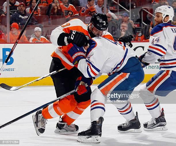 Radko Gudas of the Philadelphia Flyers hits Taylor Hall of the Edmonton Oilers at the Wells Fargo Center on March 3 2016 in Philadelphia Pennsylvania...