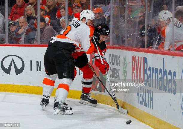 Radko Gudas of the Philadelphia Flyers in action against Miles Wood of the New Jersey Devils on February 1 2018 at Prudential Center in Newark New...