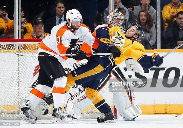 Radko Gudas of the Philadelphia Flyers is called for a high stick against Calle Jarnkrok of the Nashville Predators during an NHL game at Bridgestone...