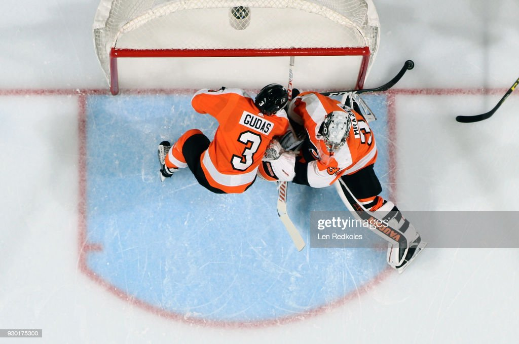Radko Gudas #3 of the Philadelphia Flyers reaches behind goaltender Petr Mrazek #34 to push the puck away from the net during their game against the Winnipeg Jets on March 10, 2018 at the Wells Fargo Center in Philadelphia, Pennsylvania. The Flyers went on to defeat the Jets 2-1.