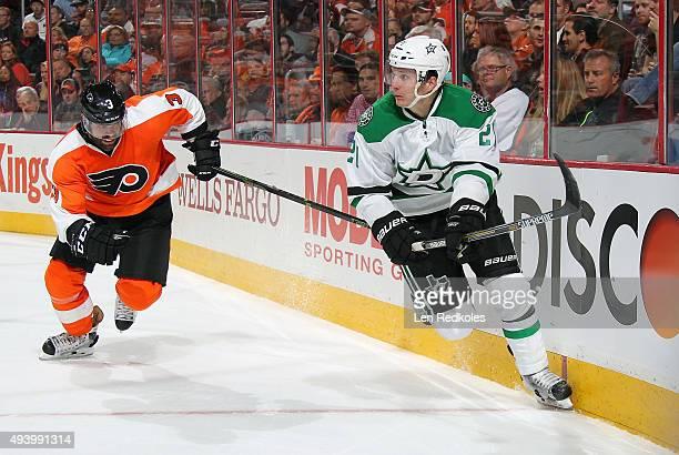 Radko Gudas of the Philadelphia Flyers skates along the boards against Antoine Roussel of the Dallas Stars on October 20 2015 at the Wells Fargo...
