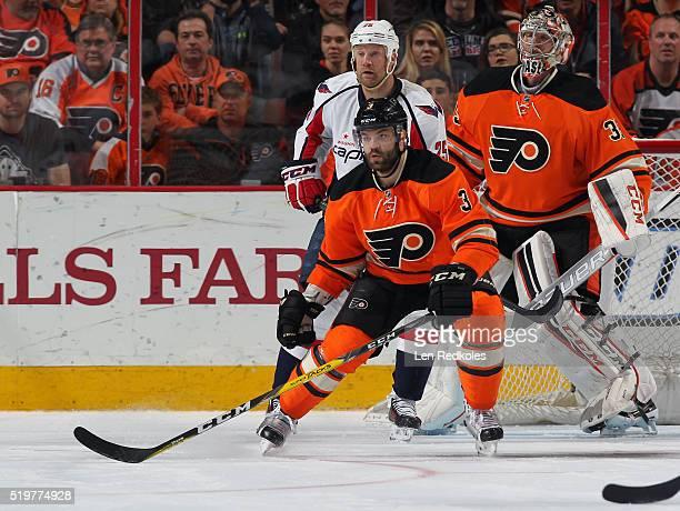 Radko Gudas of the Philadelphia Flyers skates back on defense against Jason Chimera of the Washington Capitals in front of goaltender Steve Mason on...