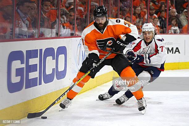 Radko Gudas of the Philadelphia Flyers skates past TJ Oshie of the Washington Capitals during the first period in Game Six of the Eastern Conference...