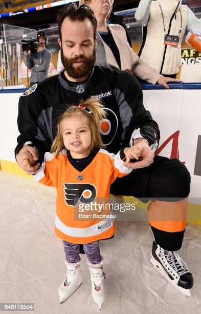 Radko Gudas of the Philadelphia Flyers skates with his daughter during the family skate as part of the 2017 Coors Light NHL Stadium Series game to be...