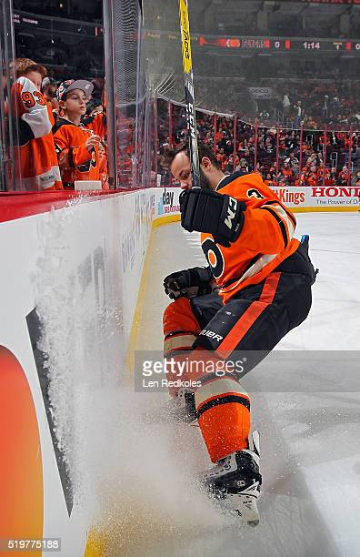 Radko Gudas of the Philadelphia Flyers sprays ice along the boards as he leaves the ice surface following warmups against the Washington Capitals on...