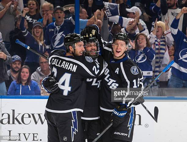 Radko Gudas of the Tampa Bay Lightning celebrates his goal with teammates Ryan Callahan and Ondrej Palat during the third period against the New York...