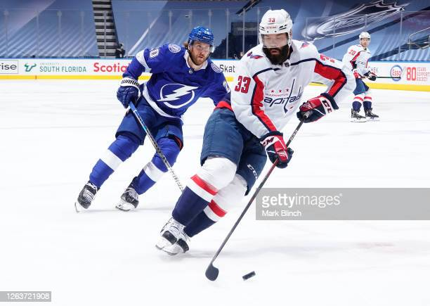 Radko Gudas of the Washington Capitals and Blake Coleman of the Tampa Bay Lightning skate during a Round Robin game during the 2020 NHL Stanley Cup...