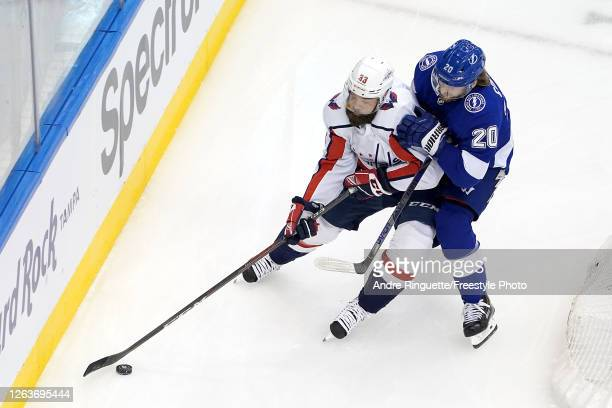 Radko Gudas of the Washington Capitals battles for the puck with Blake Coleman of the Tampa Bay Lightning during the first period in Game One of the...
