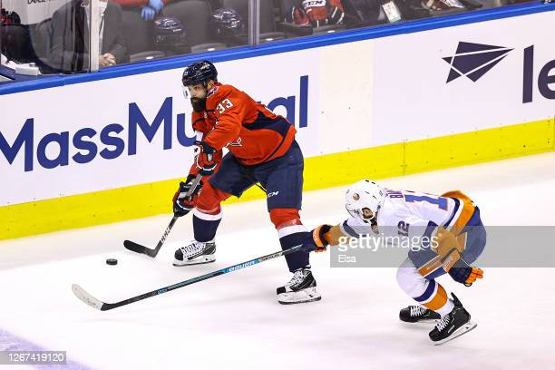Radko Gudas of the Washington Capitals is defended by Josh Bailey of the New York Islanders during the first period in Game Five of the Eastern...