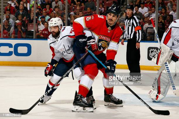 Radko Gudas of the Washington Capitals tangles with Brian Boyle of the Florida Panthers at the BBT Center on November 7 2019 in Sunrise Florida