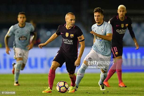 Radoja of RC Celta de Vigo competes for the ball with Andrés Iniesta of FC Barcelona during the La Liga match between Real Club Celta de Vigo and...