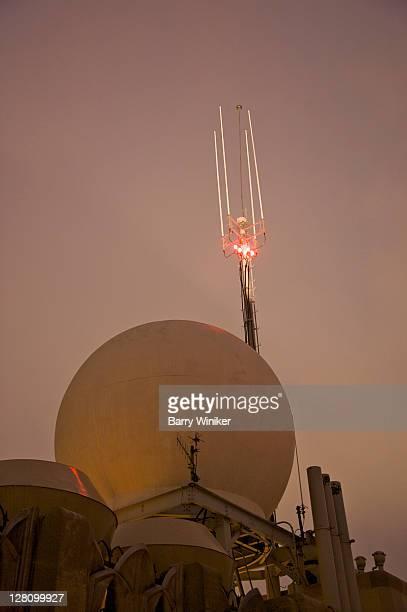 Radome, radar and dome, atop Rockefeller Center, and nearby antenna, at dusk, New York, NY